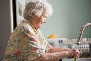 Older lady working in kitchen